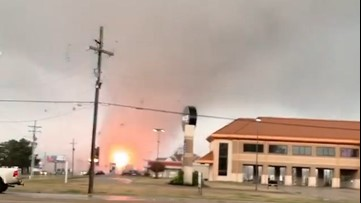 Large tornado sends sparks flying from damaged power line