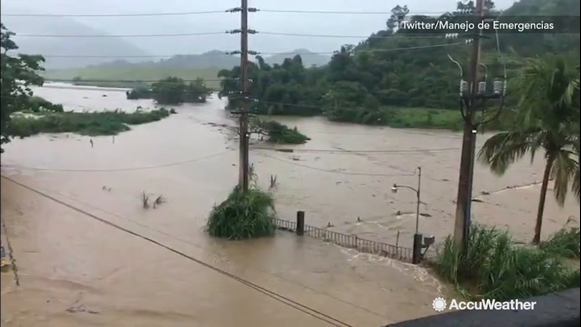 Floodwaters pour over river channels after vigorous downpours