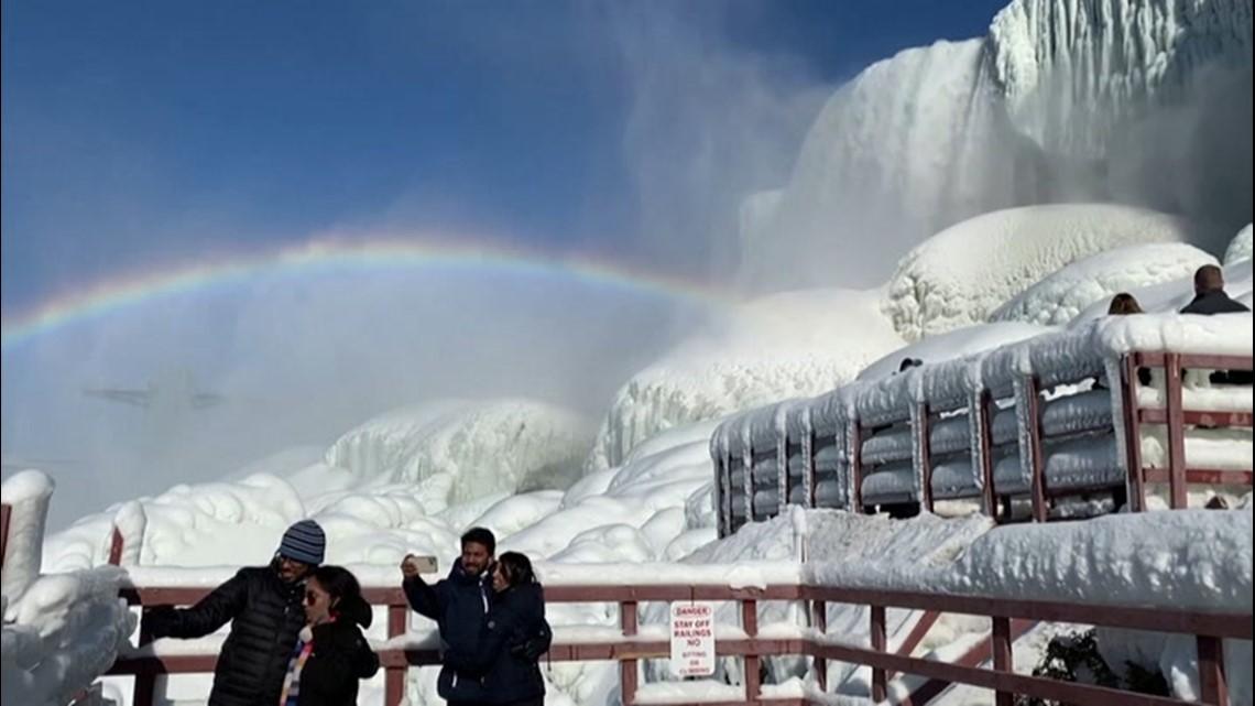 Rainbow hangs over a frozen Niagara Falls