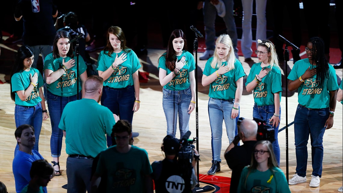 29e16c5af35a The Santa Fe High School choir performs the national anthem as part of a  tribute to honor the victims of the May 18 shooting at Santa Fe High School  prior ...