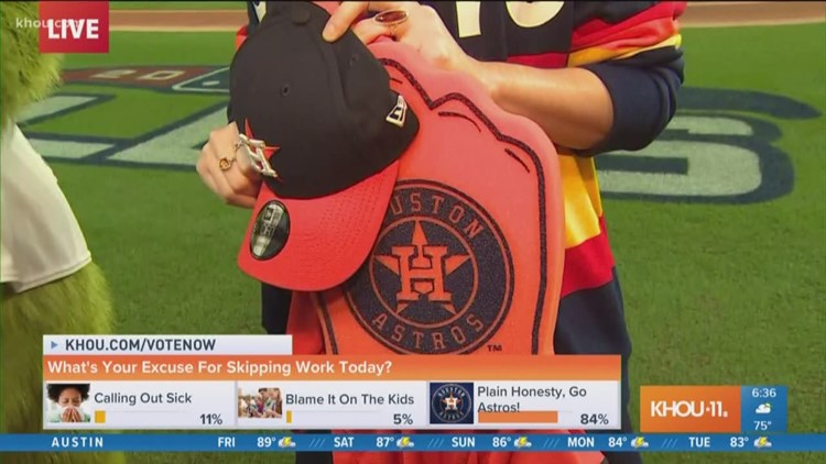 Orbit and Brandi show off swag from Astros store at Minute Maid