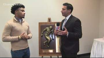 Mike Canizales speaks with a pair of Willie Ray Smith Award finalists