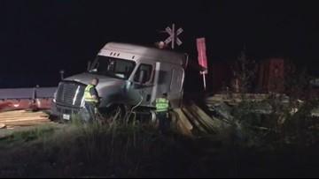 Train hits 18-wheeler carrying lumber in Orange early Monday morning