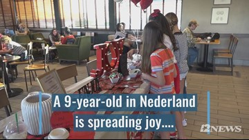 Nederland girl spreading love with Starbucks cup sleeves