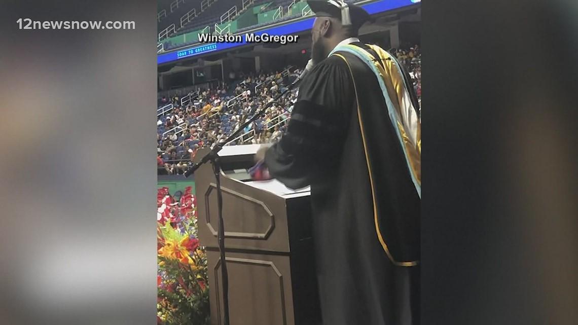 Highschool principal serenades students at gradution