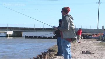 Fence construction begins at Rollover Pass, blocking fishermen from using the spot