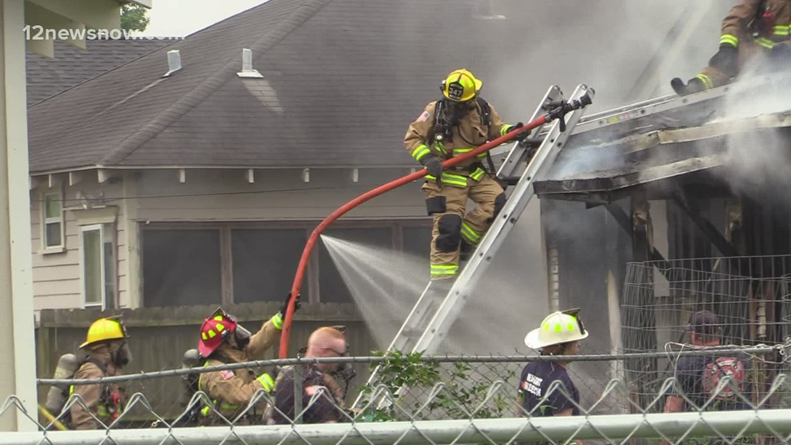 Beaumont neighbors rescue two men from burning home
