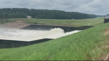 Water flows through the spillway at the Toledo Bend Reservoir Friday morning