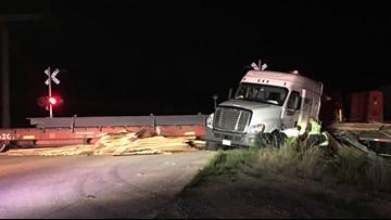 Train hits 18-wheeler carrying lumber, scatters wood across roadway in Orange
