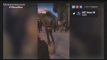 Parisians gather, sing following Notre Dame fire