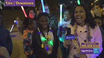 Mardi Gras Highlights | Children dancing with lightsabers with 12News reporter Kierra Sam