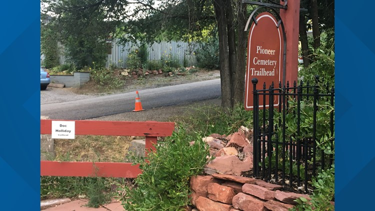 Signs for trail towards Doc Holliday gravesite