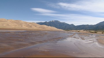 Headed to the Great Sand Dunes in Colorado to see the surge flow? Here's what you need to know.