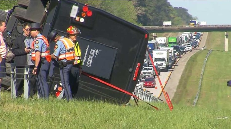 Charter bus overturns I-20 Eastbound, driver charged with DUI