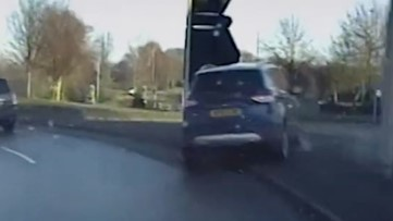 Dramatic, High-Speed Pursuit Through Residential Area Caught on Police Dashcam