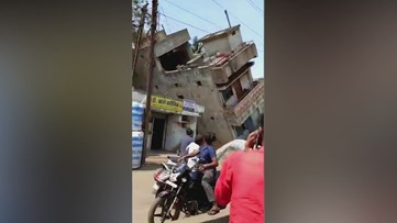 Shocking Footage Shows a Two-Story Building Collapsing, Nearly Crushing Pedestrians Below