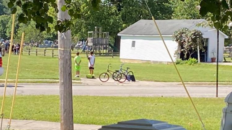 Indiana boys stop bike ride to pay respects at veteran's funeral