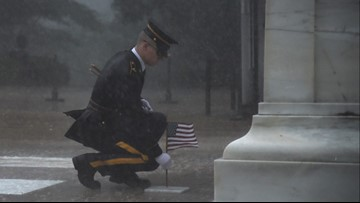 Moving photo captures flag being placed at Tomb of Unknown Soldier during severe rainstorm