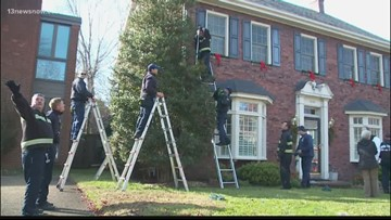 Norfolk firefighters finish hanging Christmas decorations