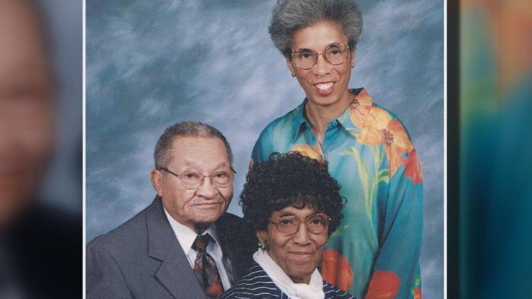 Edward and Harriett Johnson with Julie, one of their three daughters, in 2001